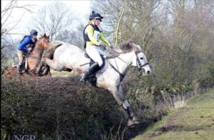 Soleada and Amy jumping big hedge and ditch combo.